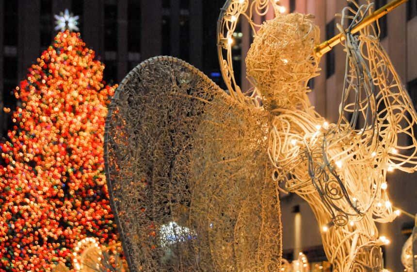 Angel sculpture in front of the Rockefeller Center Christmas sculpture in New York.